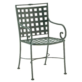 Pictured is the Sheffield Dining Arm Chair from Woodard Outdoor Furniture, sold by Timeless Wrought Iron.