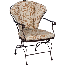 Pictured is the Brayden Coil Spring Dining Chair from Woodard Outdoor Furniture, sold by Timeless Wrought Iron.