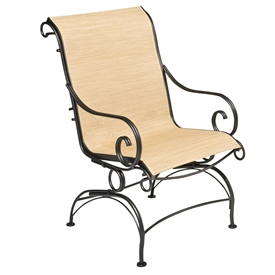 Pictured is the Terrace Sling Coil Spring Dining Chair from Woodard Outdoor Furniture, sold by Timeless Wrought Iron.