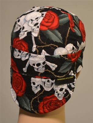 Welder cap has skulls w/red roses and green leaves and brown thorns.