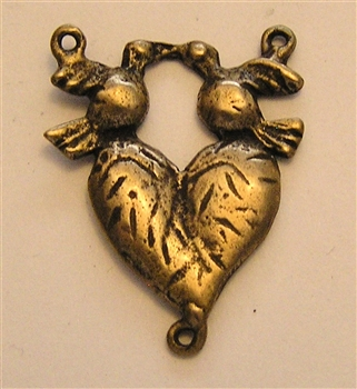 "Center, Heart/Two Doves. Available in bronze or sterling. 1""."