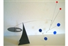 black, blue, and red modern calder style hanging tabletop mobile