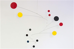 black, yellow and red modern calder style hanging mobile