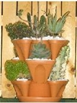 terracotta vertical growing planter, multi-level gardener's pot.