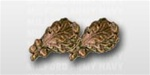 "Attachment:   Bronze Oak Leaf Cluster - 5/16"" - 2 On Bar - For Ribbon or Full Size Medal"