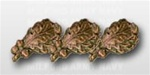 "Attachment:   Bronze Oak Leaf Cluster - 5/16"" - 3 On Bar - For Ribbon or Full Size Medal"