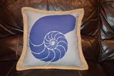 Blue nautilus shell on grey pillow
