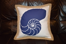 Blue nautilus shell on white pillow