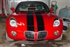 "Red Saturn Sky w/ Black 10"" Twin Rally Stripes"