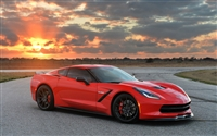 Red Corvette w/ Setting sun in background
