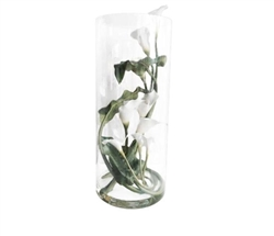 This beautiful floral arrangement features a clear glass base with white Callas Lilies on a vine carefully crafted to look seemingly real.