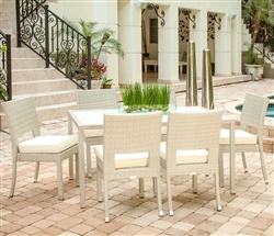 Vito outdoor dining set seats six and is available in espresso or  New ligh grey rattan with off-white cushions