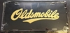 Oldsmobile (Black) License Plate