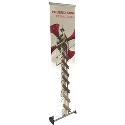 16in x 63in Phoenix Mini Full Height Retractable Tabletop Banner Stand with Vinyl Banner - a small tabletop-sized version of larger roll-up signs. View a wide variety of portable banner stands to use at your tradeshows and conferences