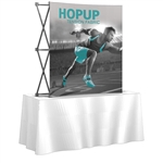 5ft x 5ft HopUp Curved Tabletop Display Front Graphic Only. HopUp Display has a light weight, heavy duty frame that holds a fabric graphic mural. Durable stretch fabric graphic stays attached to the HopUp frame for fast and efficient use.