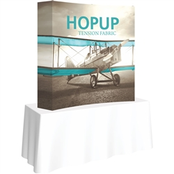 5ft X 5ft Curved HopUp 2x2 Tabletop Fabric Display with Full Fitted Graphic  is a lightweight and versatile trade display solution for users who need an exhibit that sets up in seconds. Portable, Vibrant Table Top Displays
