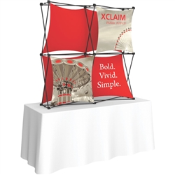 5ft Xclaim 3-D PopUp Table Top Display Kit 01 with Full Fabric Graphics. Portable tabletop displays and exhibits. Several different styles are available, including pop up frames with stretch fabric or fold up panels with custom graphics.