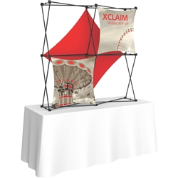 5ft Xclaim 3-D PopUp Table Top Display Kit 03 with Full Fabric Graphics. Portable tabletop displays and exhibits. Several different styles are available, including pop up frames with stretch fabric or fold up panels with custom graphics.