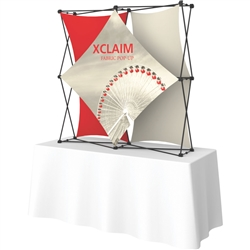 5ft Xclaim 3-D PopUp Table Top Display Kit 02 with Full Fabric Graphics. Portable tabletop displays and exhibits. Several different styles are available, including pop up frames with stretch fabric or fold up panels with custom graphics.