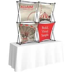 5ft Xclaim 3-D PopUp Table Top Display Kit 04 with Full Fabric Graphics. Portable tabletop displays and exhibits. Several different styles are available, including pop up frames with stretch fabric or fold up panels with custom graphics.