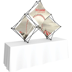 8ft Xclaim Tabletop 3 Quad Pyramid Fabric Popup Display Kit 01 with Full Fabric Graphics. Portable tabletop displays and exhibits. Several different styles are available, including pop up frames with stretch fabric or fold up panels