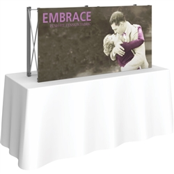 5ft Embrace Tabletop Push-Fit Tension Fabric Display with Front Graphic. Portable tabletop displays and exhibits. Several different styles are available, including pop up frames with stretch fabric or fold up panels