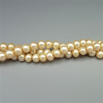 "5-5.5mm round champagne fresh water pearls, one 16"" strand"