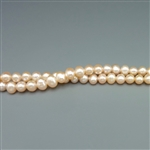 "4.5mm round natural pink fresh water pearls, one 16"" strand"