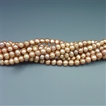 "4.5mm round dark champagne fresh water pearls, one 16"" strand"