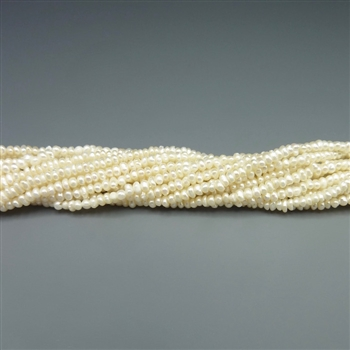 "2mm button white fresh water pearls, one 16"" strand"