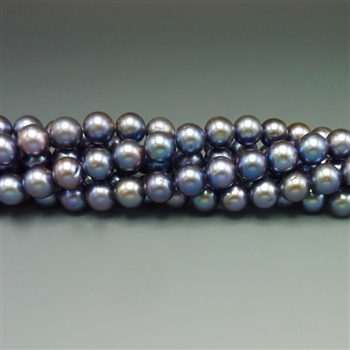 "8mm round purply-blue fresh water pearls, one 16"" strand"