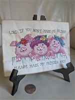 Needlepoint work piglets with quotation