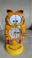 Garfield standing alarm clock swinging pendulum
