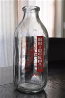 One Quart vintage Bottle with advertising vintage