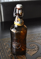 Amber glass embossed FISHER beer bottle
