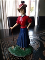 Cast iron woman golfer door stop