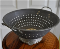 Vintage aluminum colander storage display