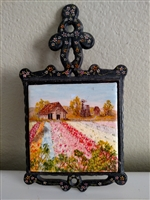 Vintage trivet with hand painted tile