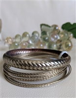 Gold tone metal set of bangle bracelets
