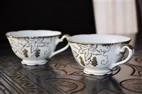 NAPCO porcelain set of two teacups gold embossed