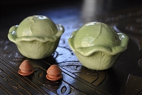 Green cabbage heads salt and pepper shakers