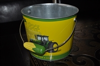 "John Deere tin bucket ""Nothing Runs Like a Deere""."
