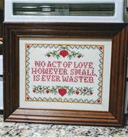 Needlepoint work phraze in wooden frame