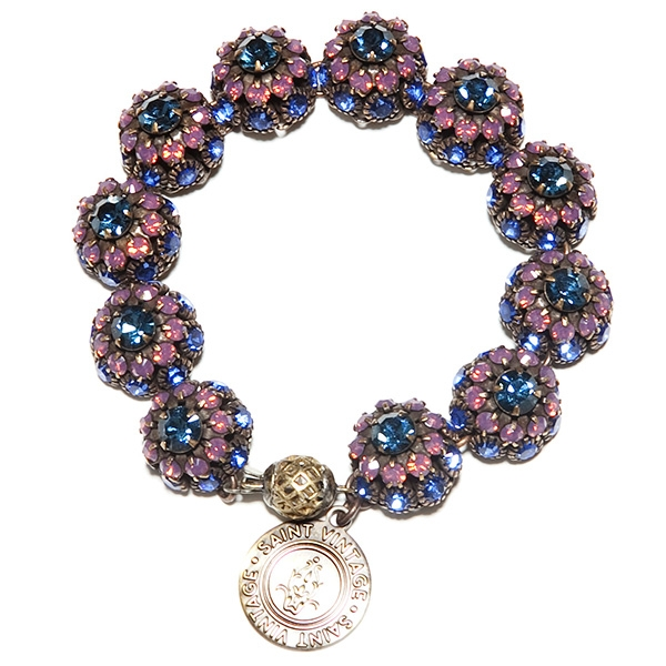 "Beautiful amethyst and sapphire crystals are featured in this pretty bracelet with tons of sparkle. 7""in length."