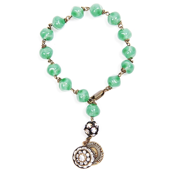 "We have created this green czech glass beaded bracelet in honor of National Cancer Prevention month. Only available for the month of February. 7"" in length. #findacure #jewelryforacause"