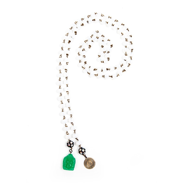 Snow white Czech glass beads are combined with a green Buddha charm and our signature SV tag. 39.5""
