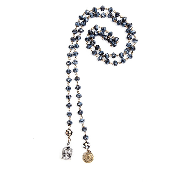 Navy Czech glass beads are combined with a crown charm meant for royalty and a signature SV tag. 39.5""