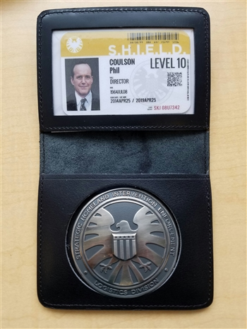 Shield Agent Metal Badge and holder.