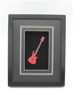 Guitar - Red Electric Magnet Bass Guitar on a Black Frame