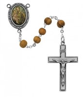 Saint Joseph rosary has olive wood beads, an image of St. Joseph for a rosary center and a pewter crucifix. Gift boxed.